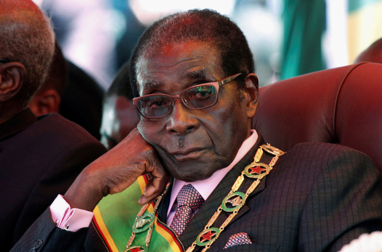 Image: FILE PHOTO -  File photo of Zimbabwe's President Mugabe looking on during a rally marking Zimbabwe's 32nd independence anniversary celebrations in Harare