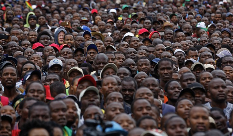 Image: Protesters gather at a demonstration for the ouster of 93-year-old leader Robert Mugabe