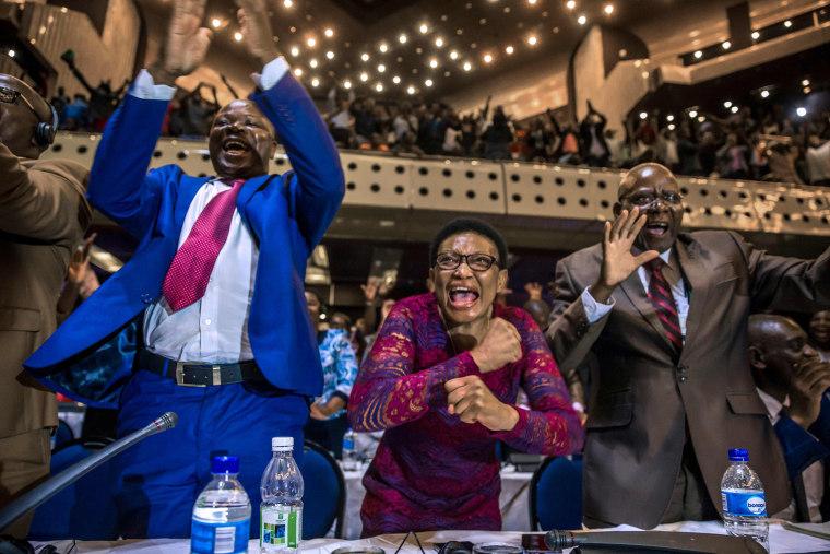 Image:  members of parliament celebrate after Mugabe's resignation