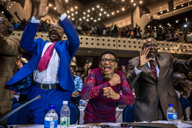 Image:  members of parliament celebrate after Mugabe's resignation