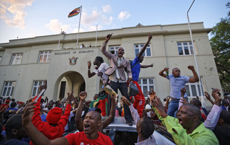 Image: Zimbabweans celebrate outside the parliament building