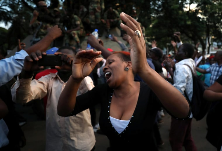 Image: Zimbabweans celebrate after Mugabe resigns in Harare