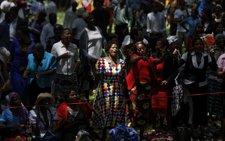 Image: Zimbabweans gather to pray for the country in a park opposite the parliament building
