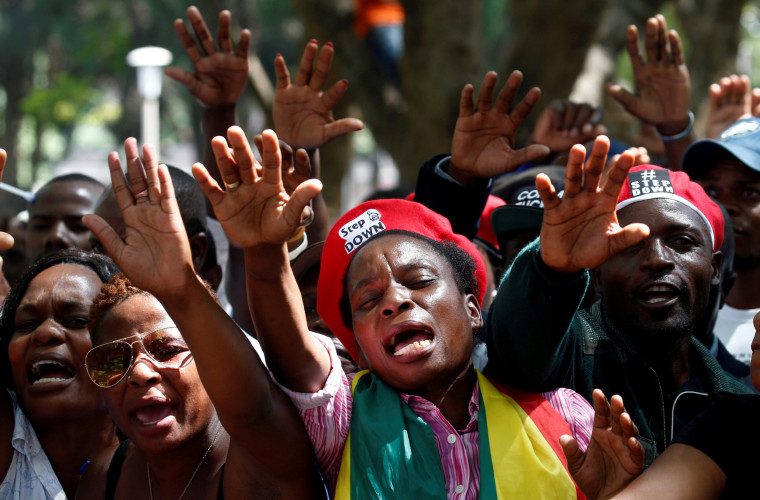 Image: Protesters calling for Zimbabwean President Robert Mugabe to resign attend a prayer meeting outside parliament in Harare