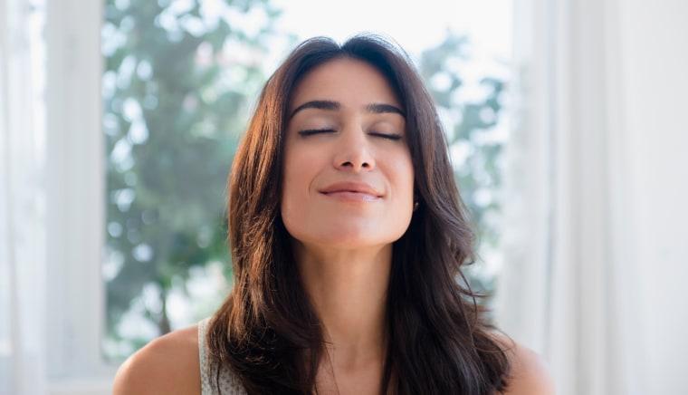 Image: A woman takes a deep breathe