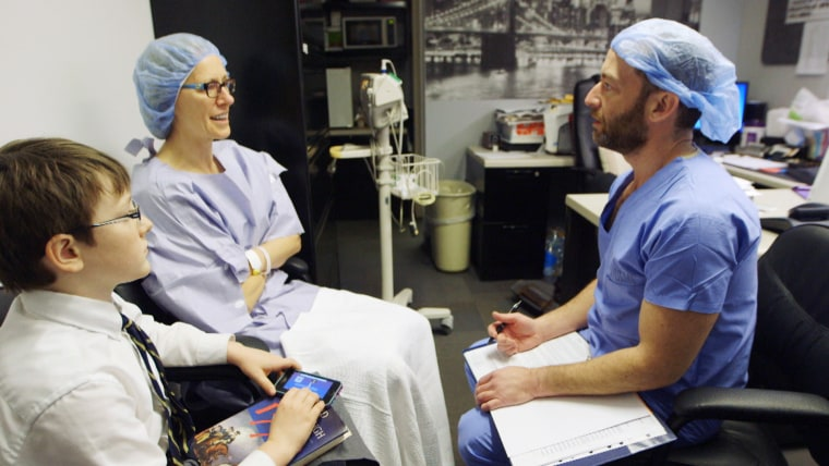 Image: Dr. Julie Luttinger and son Bobby Luttinger meet with Dr. Roy Davidovitch prior to surgery to discuss the details of her same-day hip replacement surgery.