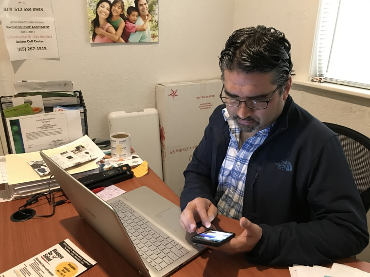 Hugo Diaz, a navigator with the Latino HealthCare Forum, checks upcoming appointments for Obamacare enrollments at the group's Austin office in November 2017.
