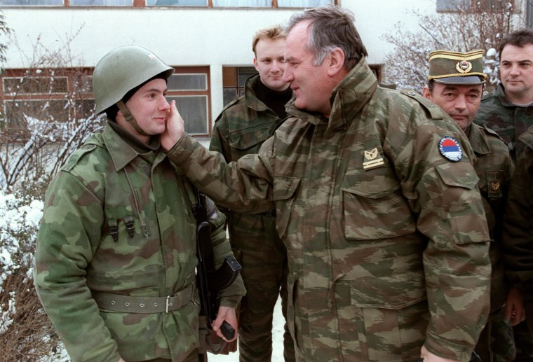 Image: Ratko Mladic pats one of his soldiers on the cheek at the Lukavica barracks