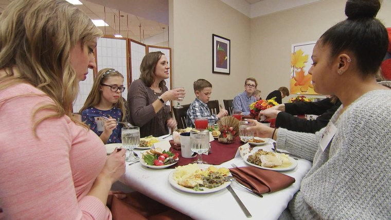 Image: Patients and families from the Children's Hospital of Wisconsin sit down for dinner, where doctors performed the high-stakes transplants with Da'Quan Nichols organs two years ago.