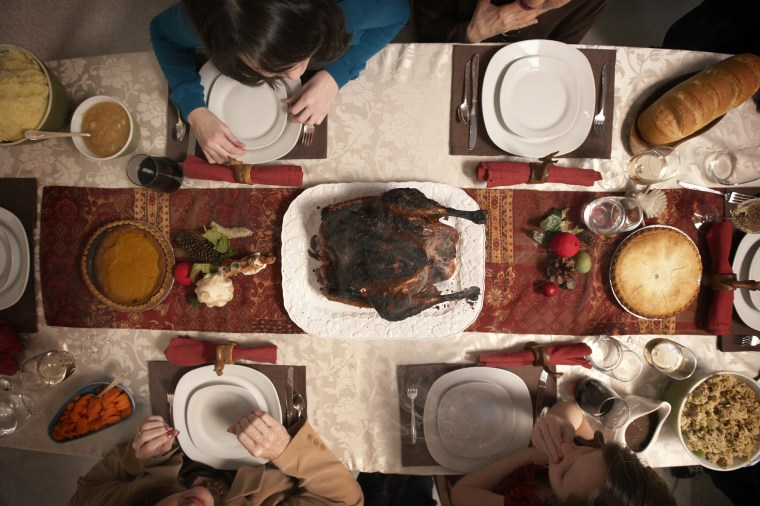 Image: Family Observing Burnt Turkey On Dining Room Table