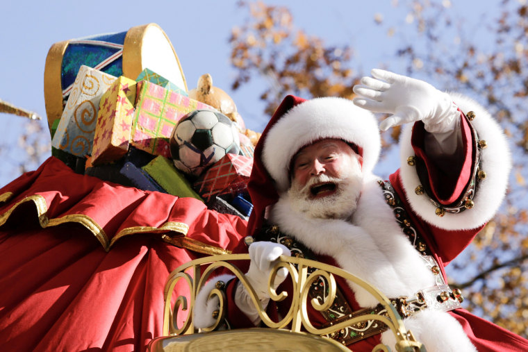 Image: Santa Claus makes his way down Central Park West during the 91st is Macy's Thanksgiving Day Parade in the Manhattan borough of New York City