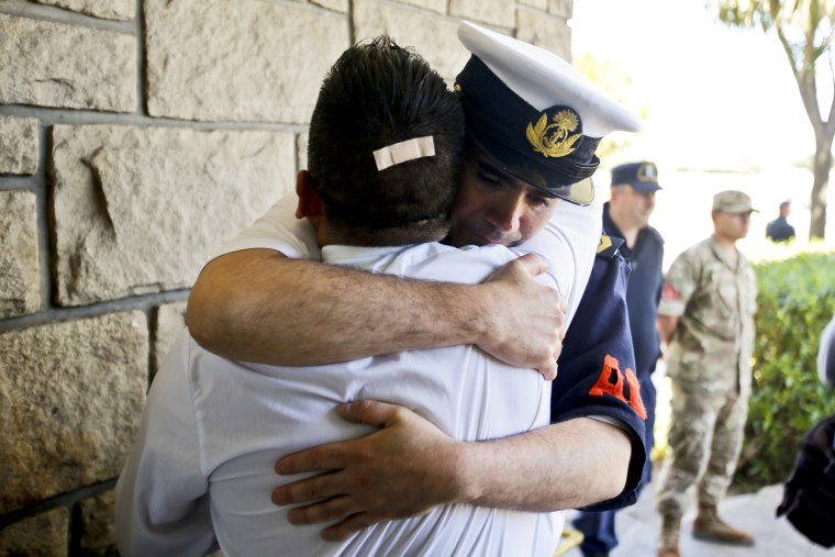 Image: Argentine Navy officials embrace inside the Mar de Plata Naval Base