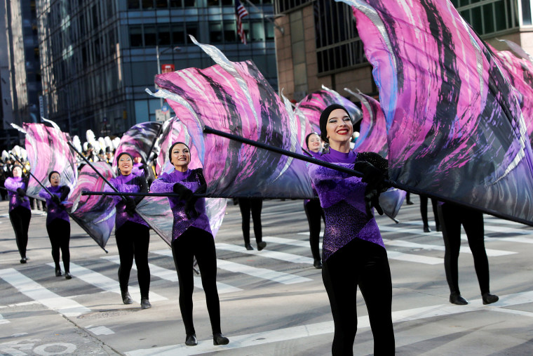 Image: Performers march along 6th Avenue during the Macy's Thanksgiving Day Parade in Manhattan, New York