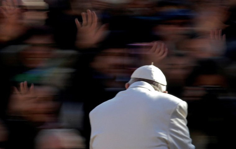 Image: Pope Francis waves as he arrives to lead the Wednesday general audience in Saint Peter's square at the Vatican