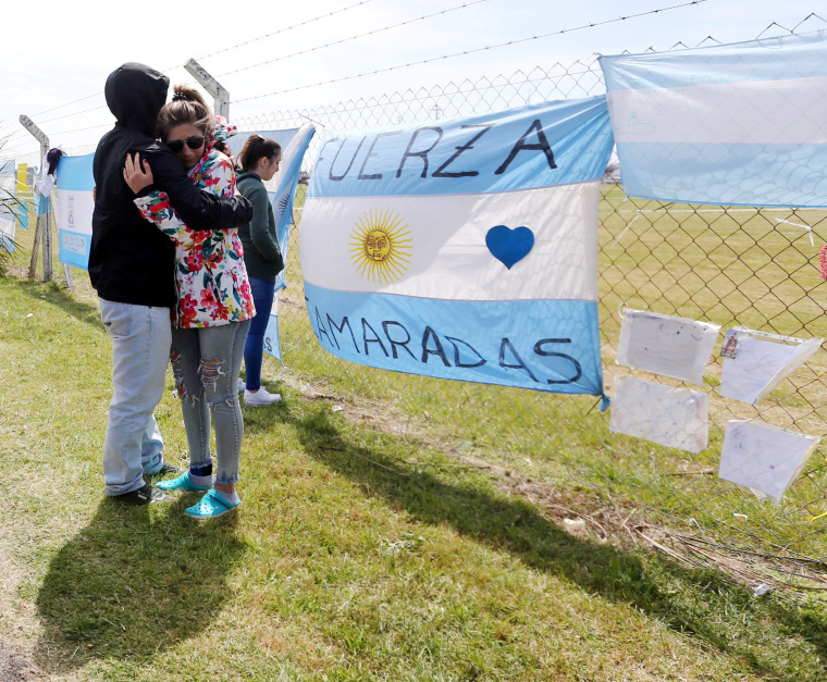 Image: Relatives and friends of Tagliapietra, one of the 44 crew members of the missing at sea ARA San Juan submarine, react outside an Argentine naval base in Mar del Plata