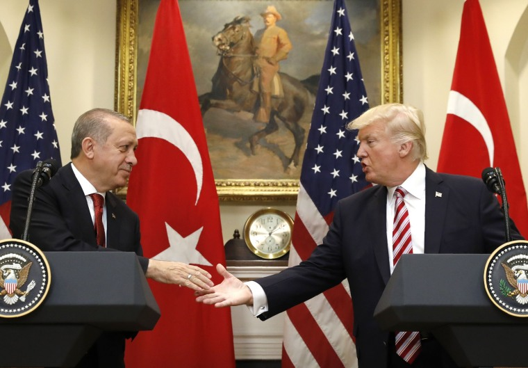 Image: Turkey's President Erdogan shakes hands with U.S. President Trump at the White House in Washington