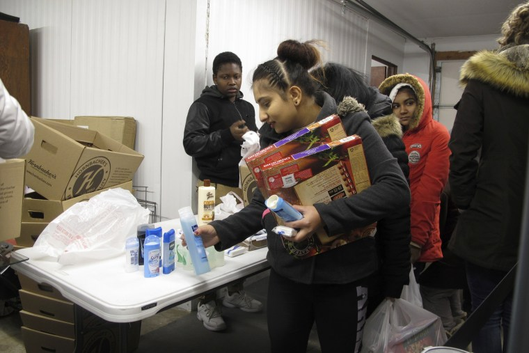 Image: Fargo residents pick up food, personal hygiene items and laundry soap at a food pantry run by students of the Legacy Children's Foundation on Nov. 16, 2017.
