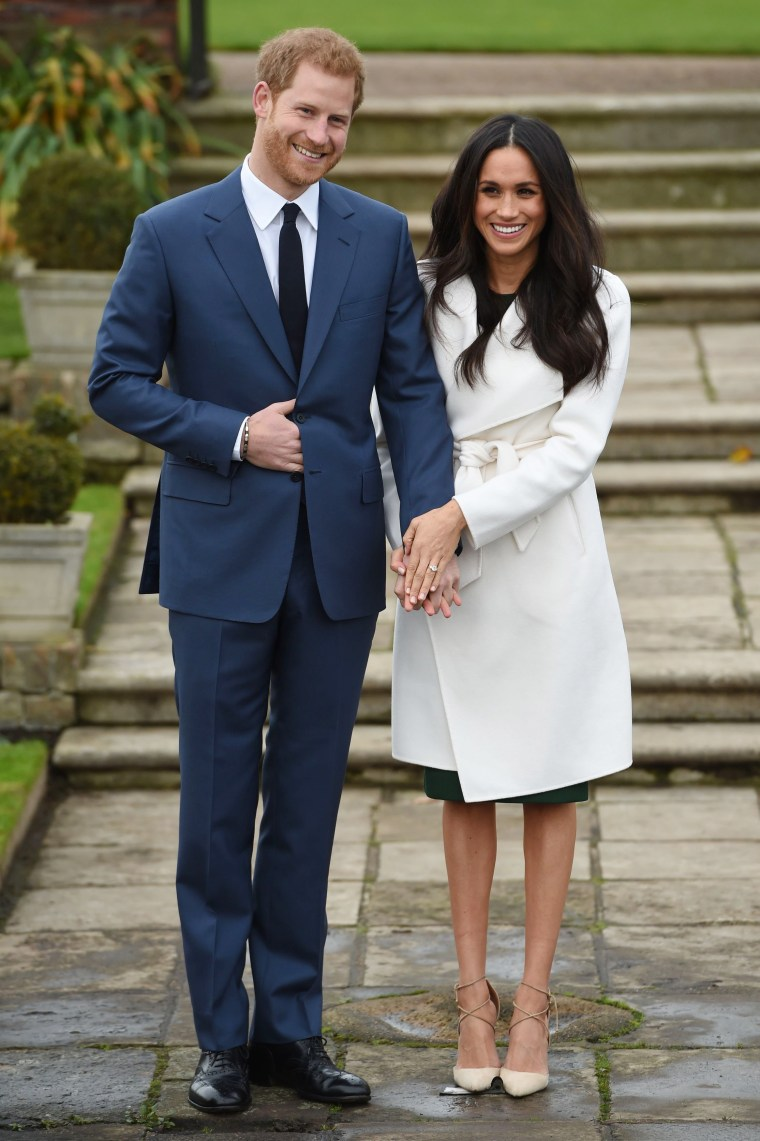 Britain's Prince Harry and Meghan Markle pose for the media in the grounds of Kensington Palace in London, Monday Nov. 27, 2017. It was announced Monday that Prince Harry, fifth in line for the British throne, will marry American actress Meghan Markle in the spring, confirming months of rumors.