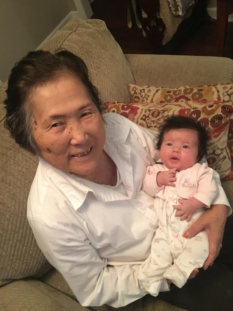 Alzheimer's patient Setsuko Harmon cradles her granddaughter Sadie.