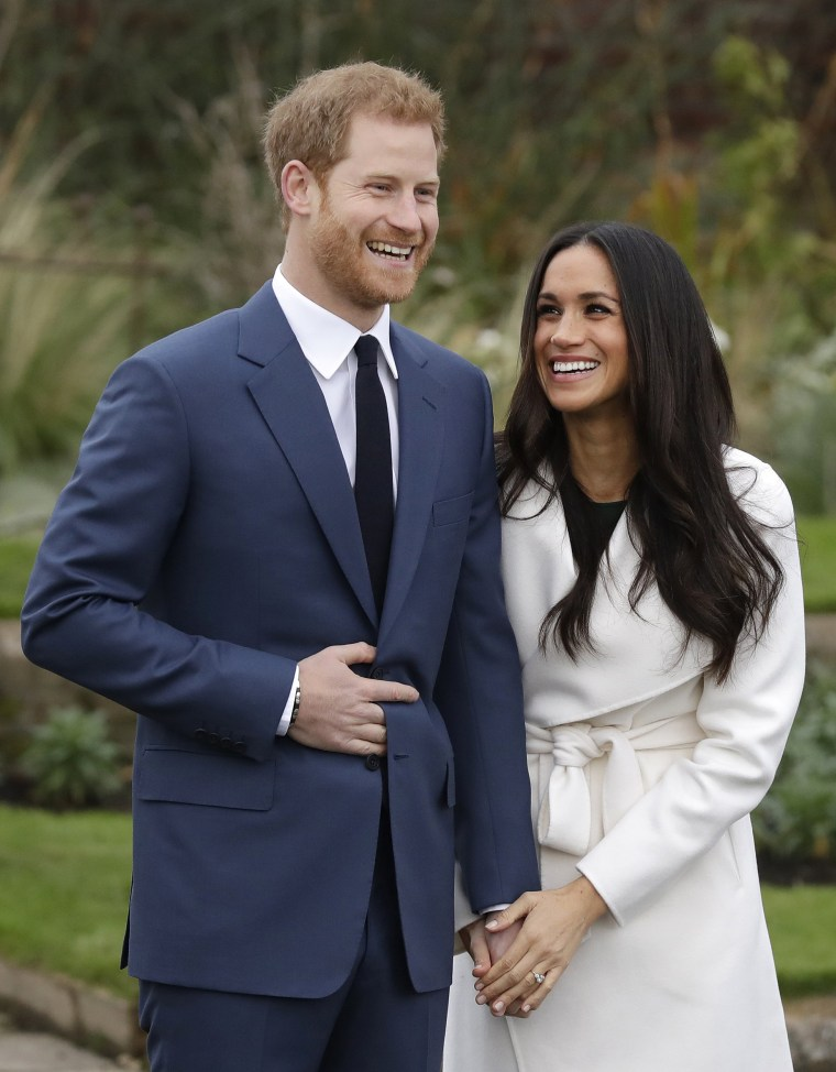 Prince Harry and Meghan Markle hold hands