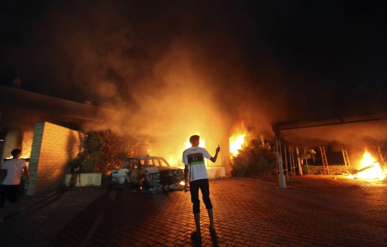 Image: The U.S. Consulate in Benghazi is seen in flames in September 2012