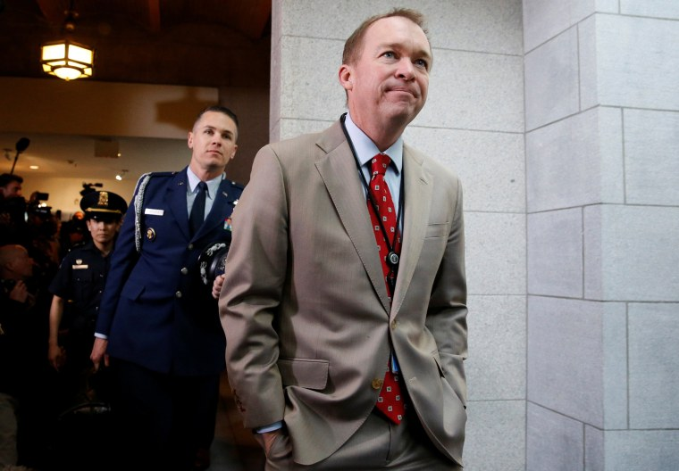Image: U.S. Office of Management and Budget (OMB) Director Mick Mulvaney arrives with President Donald Trump