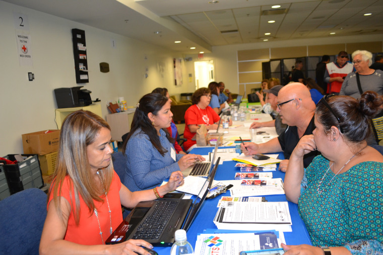 Puerto Ricans seek assistance at the hurricane relief center in Miami International Airport October 20, 2017.