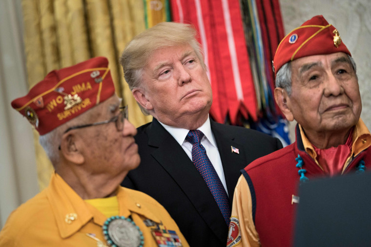 Image: President Donald Trump listens with Navajo Code Talkers in the Oval Office of the White House during an event to honor Native American code talkers who served in World War II, on Nov. 27, 2017 in Washington, DC.