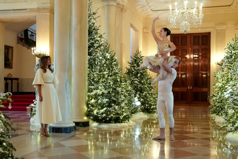 Image: Ballet dancers perform as Trump tours holiday decorations at the White House in Washington