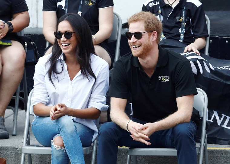 Image: Britain's Prince Harry and his girlfriend actress Markle watch the wheelchair tennis event during the Invictus Games in Toronto