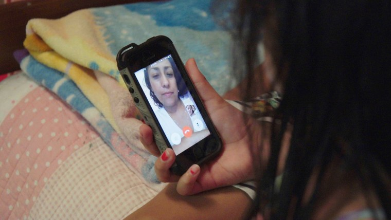 Betty Morelos Casillas speaks to her children, in Ohio, through the phone after being deported to Mexico.