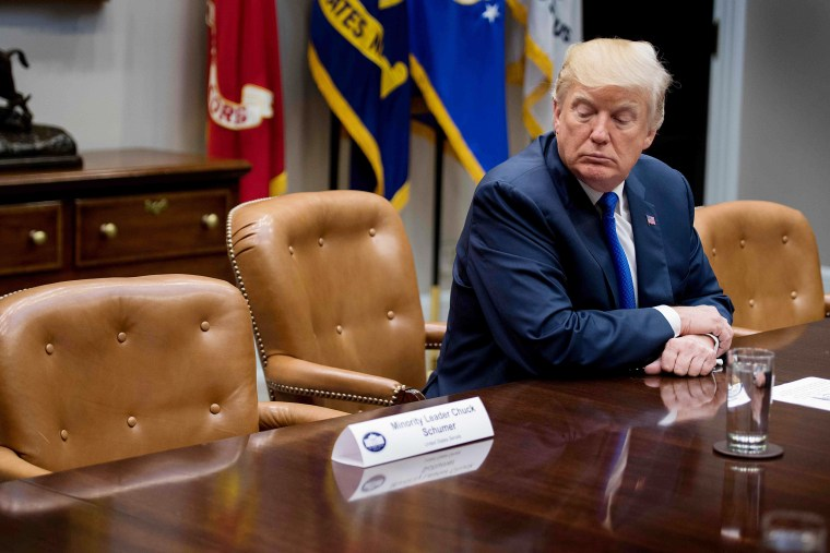 Image: US President Donald Trump looks at the empty chair of Senate Minority Leader Chuck Schumer
