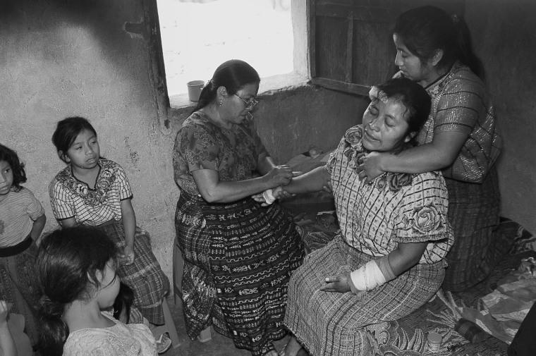 Image: Berta Navichoc, a healer and bonesetter, heals Marta Mendoza