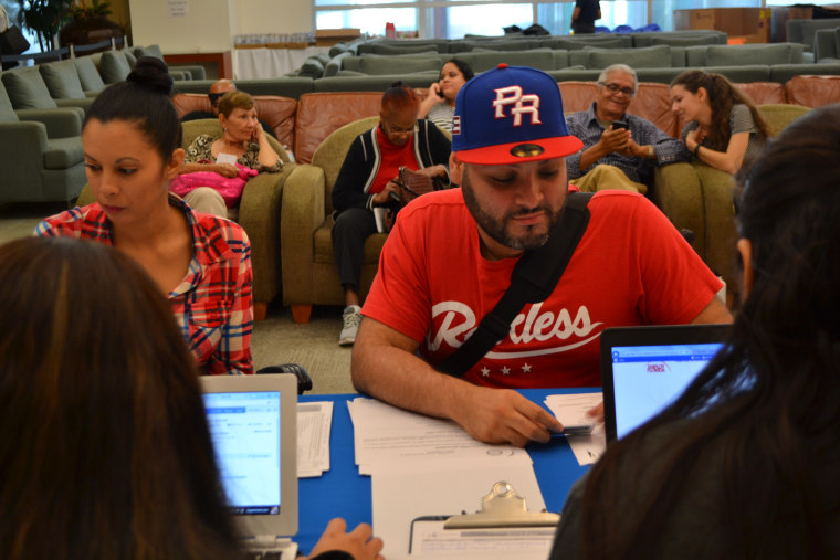 Newly arrived Puerto Ricans seek assistance at the hurricane relief center in Miami International Airport on November 29, 2017.