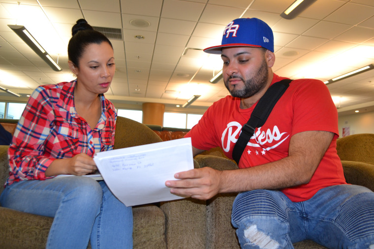 Maria Teresa Rosado (Left) and Luis Flores (Right) recently arrived from Puerto Rico. They sought assistance at the hurricane relief center in Miami International Airport on November 29, 2017.