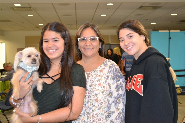 Victoria Sola (Left) with her mother, Nadya Navarro, (Center) and friend, Andrea Marrero (Left). Sola and Marrero recently arrived from Puerto Rico and have enrolled at Florida International University. They were at the hurricane relief center in Miami International Airport on November 29, 2017.