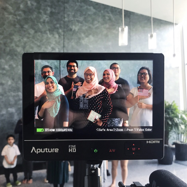 """Filmmaker Frank Chi filming a group of immigrants for Smithsonian APA Center's """"America is in the Heart"""""""