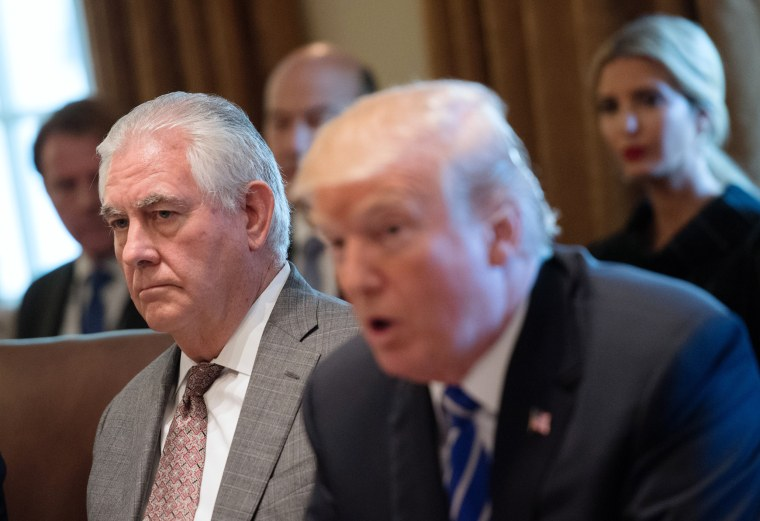Image: Secretary of State Rex Tillerson listens as President Donald Trump speaks to the media