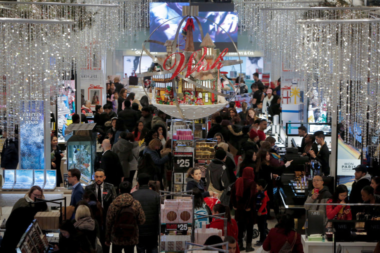 Image People shop in Macy's Herald Square during early opening for the Black Friday sales