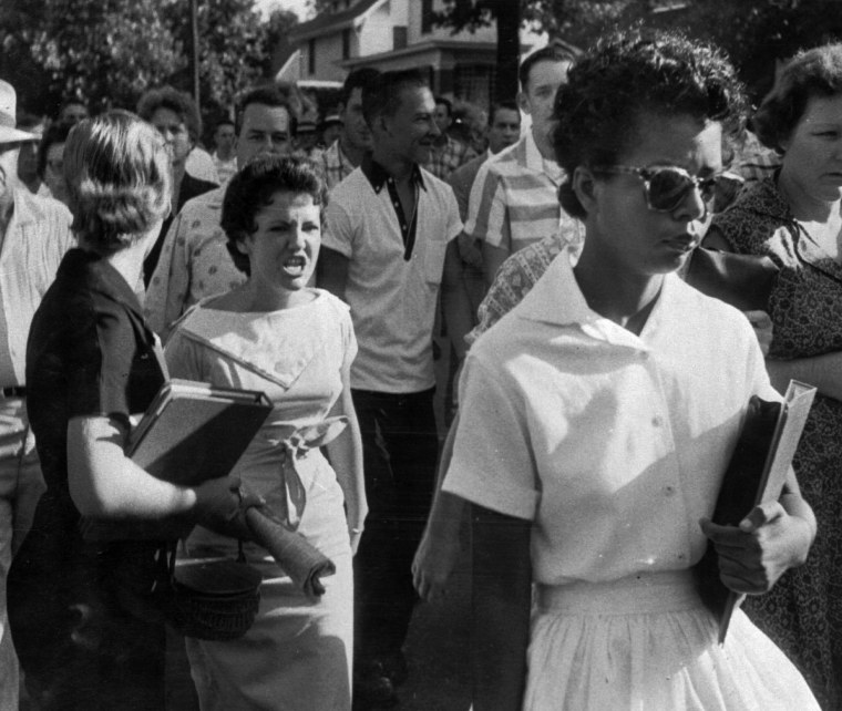 Image: Students of Central High School in Little Rock, Ark. shout insults at Elizabeth Eckford