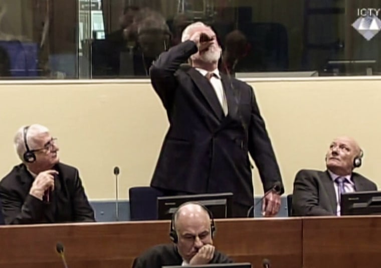 Image: Croatian former general Slobodan Praljak swallowing what is believed to be poison