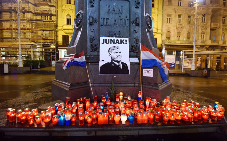 Image: Lit candles and flags are placed in tribute to General Slobodan Praljak in Zagreb