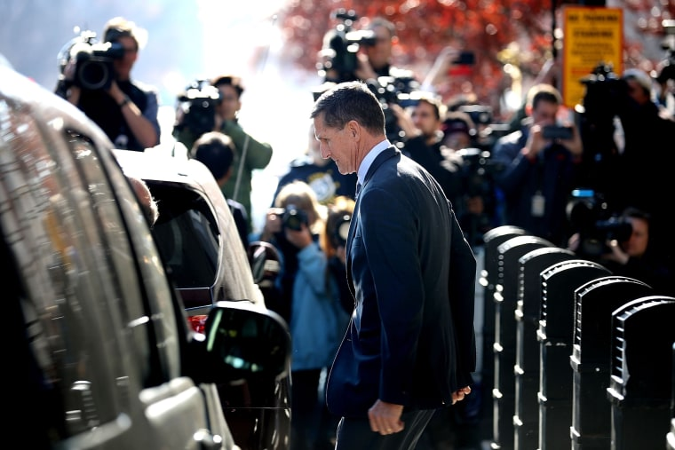 Image: Michael Flynn leaves federal court following his plea hearing