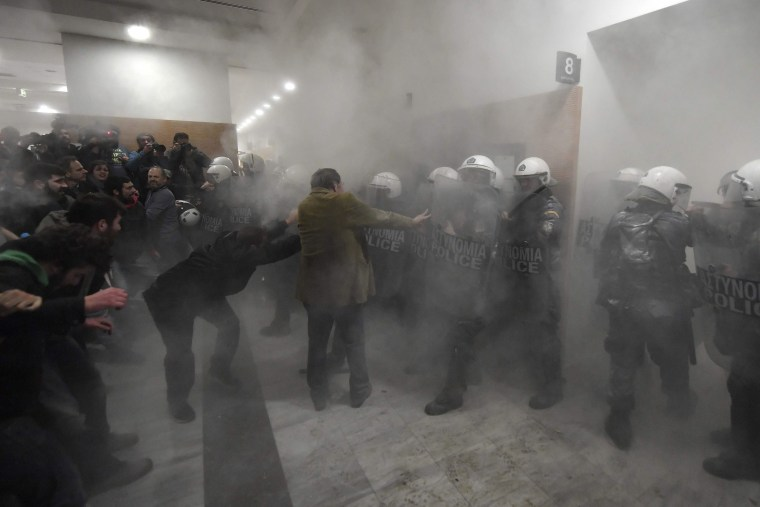 Image: Demonstrators protesting foreclosures clash with riot police in Athens