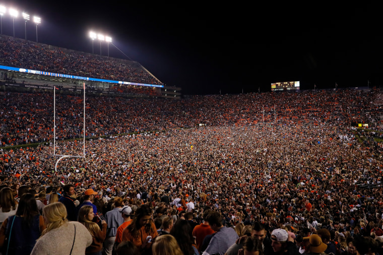 Image: Fans rush the field after Auburn defeated Alabama in the Iron Bowl NCAA college football game