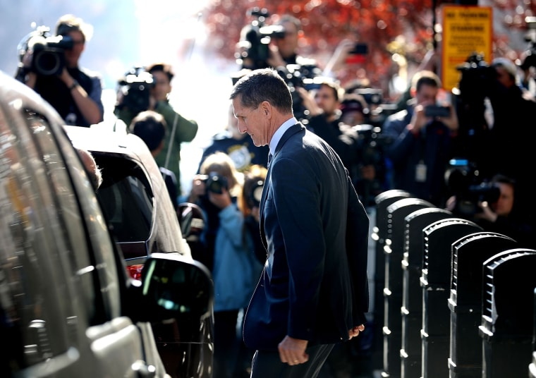 Image: Michael Flynn leaves federal court after he pleaded guilty to lying to the FBI