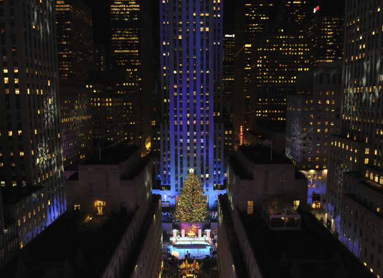 Image: The Rockefeller Center Christmas Tree glows after its official lighting