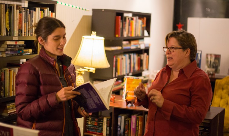 Jamie Harker (right) with a customer at Violet Valley Bookstore in Water Valley, Mississippi, on Dec. 1, 2017.