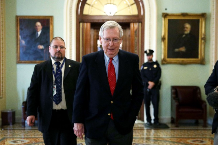 Image: U.S. Senate Majority Leader Sen. Mitch McConnell (R-KY) walks from the Senate chamber to his office on Dec. 1, 2017 at the Capitol in Washington, DC.