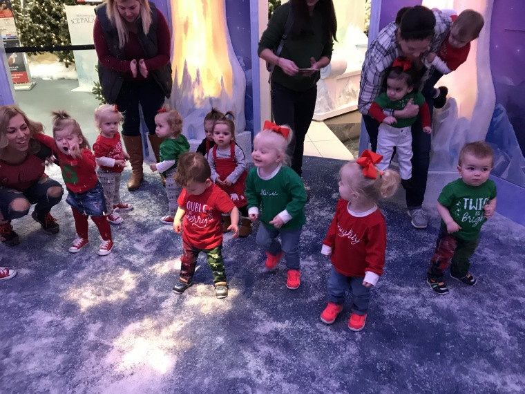 "While they waited for their turn with Santa, all 20 of the twin toddlers waited in a holding are shaped like a snow globe - complete with fake snow. ""That was the really wild part,"" said Stacy Kifer, mom of 16-month-old boys Kaleb and Kobe."